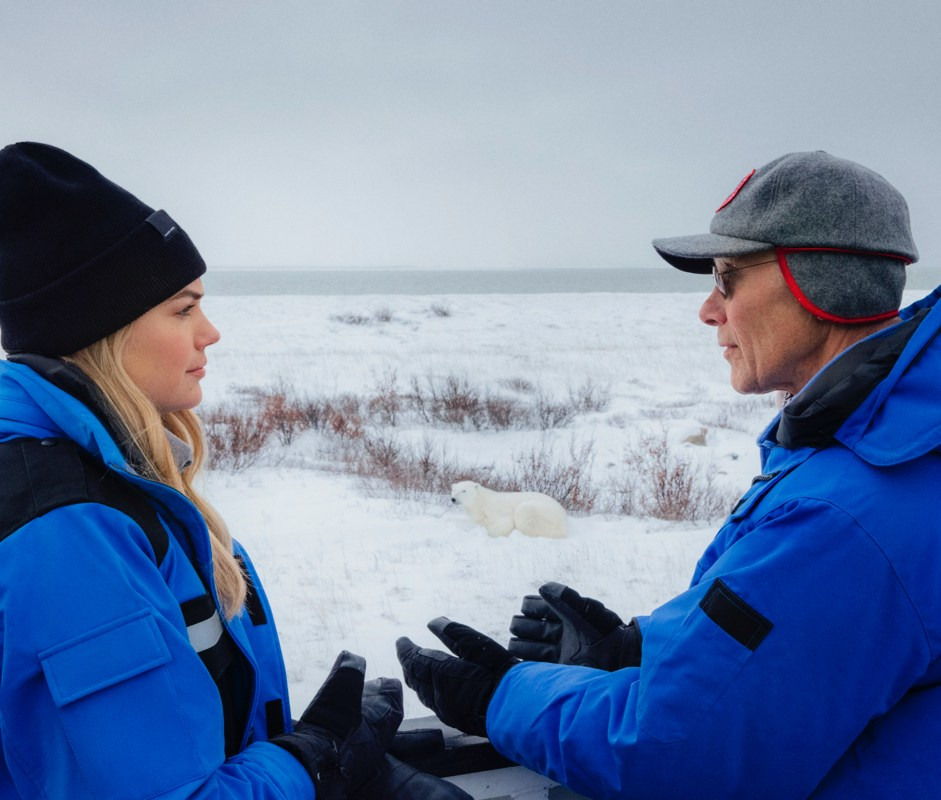 Kate Upton, wearing the PBI Photojournalist Jacket, on the ground with PBI in Churchill, Manitoba.