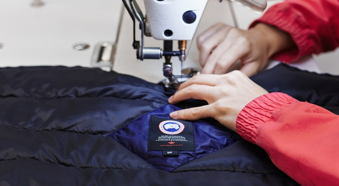 Canada Goose employee sewing